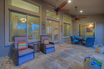 Covered back porch offers a variety of seating arrangements for spending time with the people you love best of all