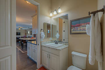 The third bathroom features a walk-in shower