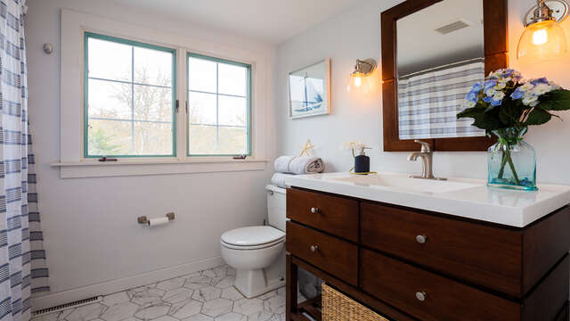 Full bath at top of stairs in hall.  790 Queen Anne Road Harwich- Cape Cod New England Vacation Rentals