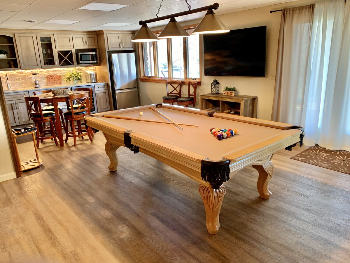 Room with pool table and nearby seating