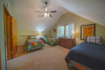 Upper level bedroom with three twin beds
