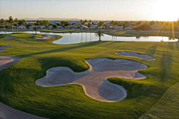 Appealing golf course and lake views add to home's charisma