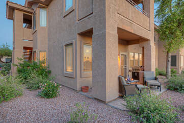Back porch with comfortable seating has impressive views of the adjacent golf course.