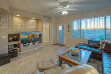 Large TV competes with engaging view from great room windows