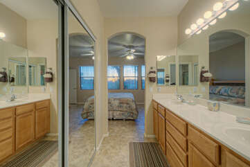The primary suite has a private bath and walk-in closet