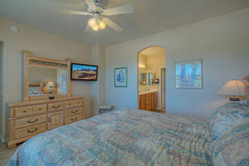 Feel at home in primary suite with TV for private viewing and ample storage for your wardrobe and accessories