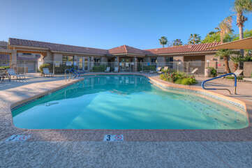 Community center with heated pool, spa and work out room are directly across the street from condo