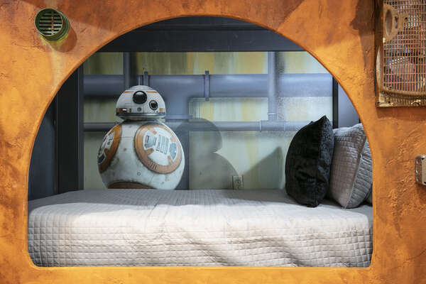 Each secluded bed area is personalized with fun characters