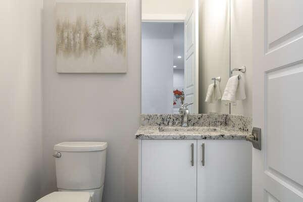 A hallway half bathroom
