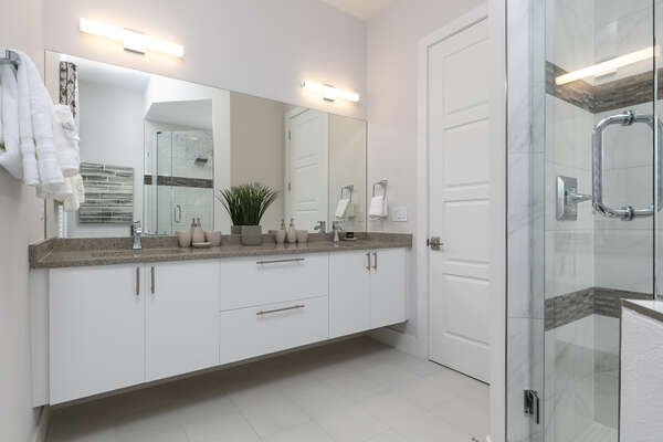 The ensuite bathroom has a gorgeous walk-in shower