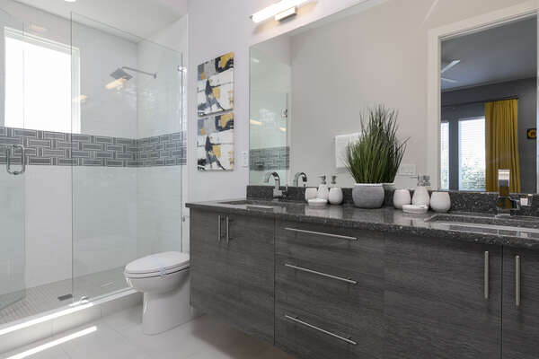 Walk right into the ensuite bathoom and get ready for the day at the dual sink vanity