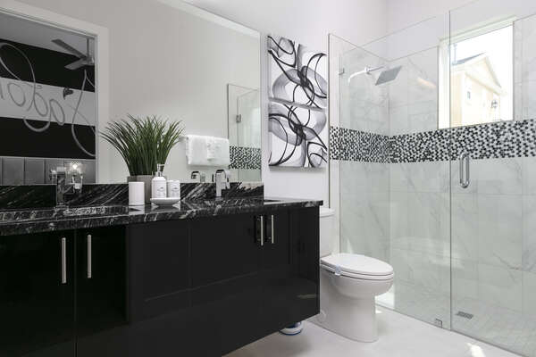 The ensuite bathroom with elegant details and a walk-in shower