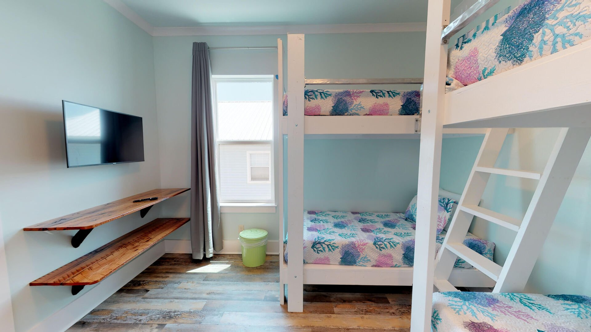 Bedroom 3 on the 1st floor has 2 sets of twin bunks and a smart TV.