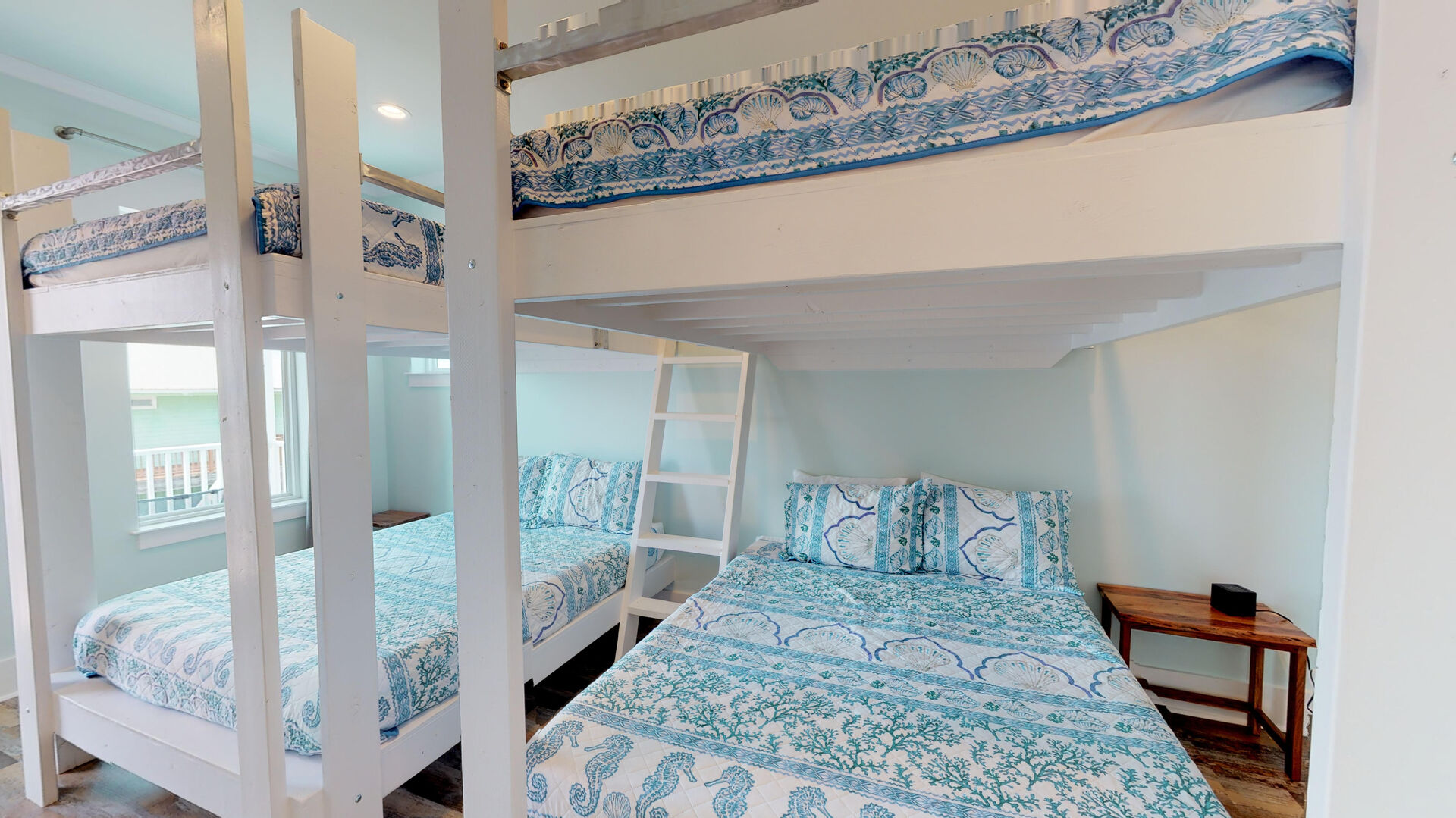 Queen bunk beds in one of this rental's bedrooms.