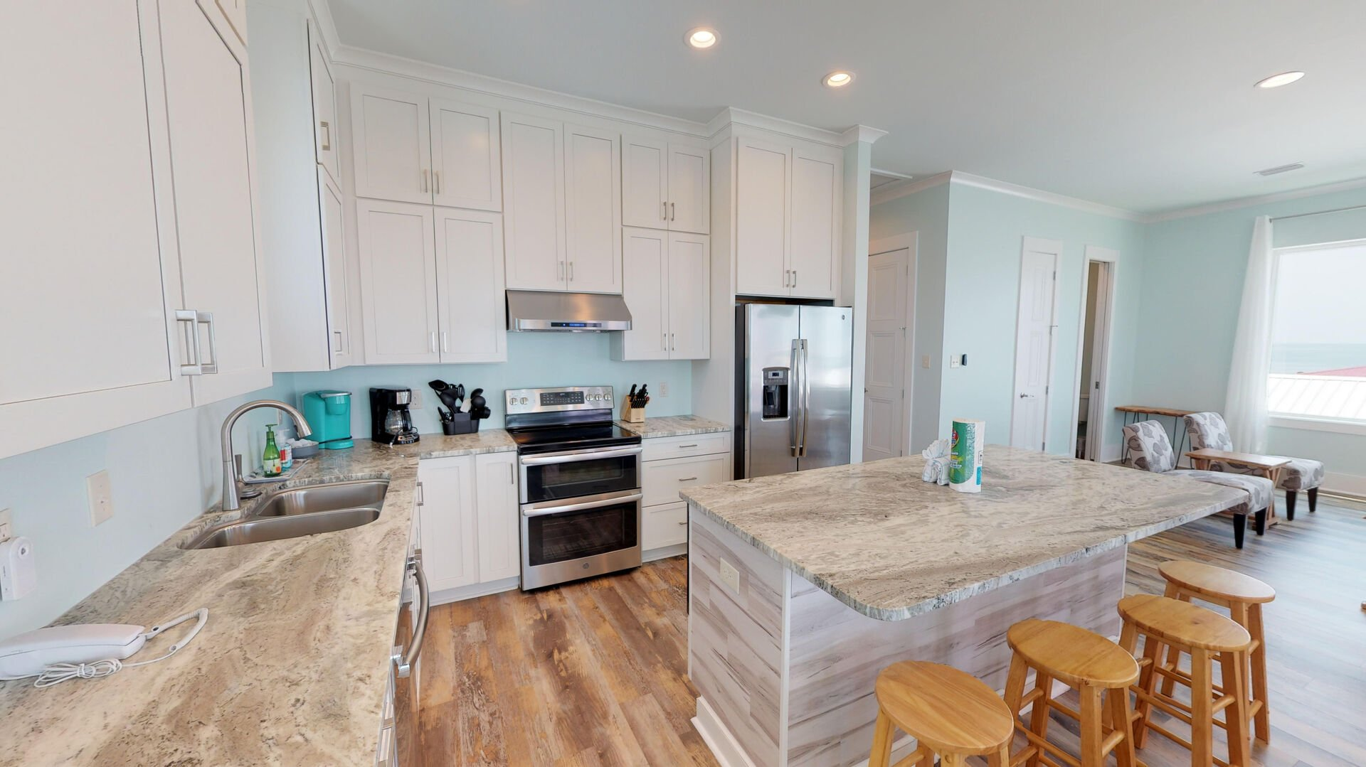 Gorgeous, fully-equipped kitchen with beautiful counter tops and modern appliances.