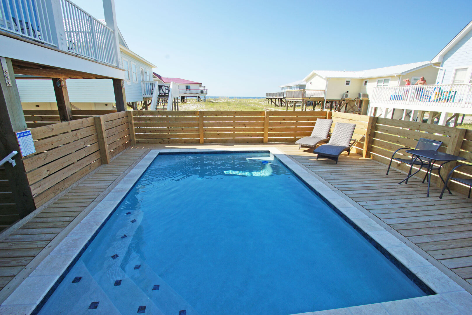 The private pool of this Vacation Home in Gulf Shores is the perfect place to relax in the sun