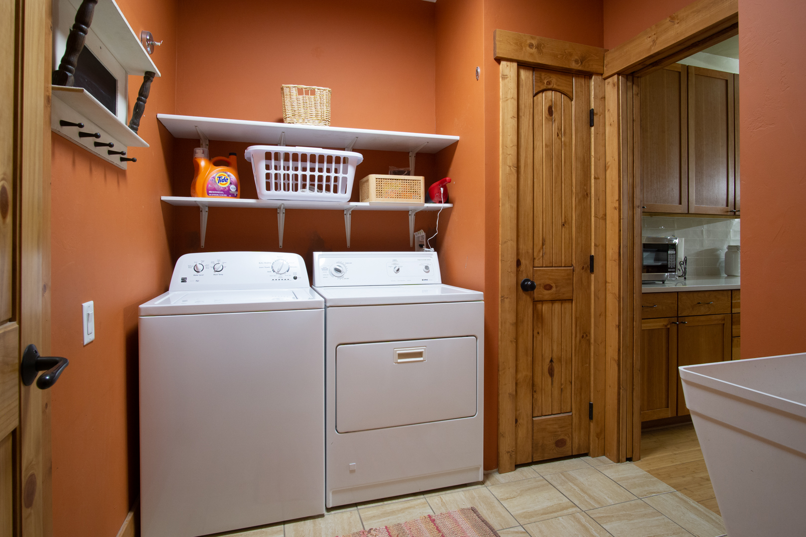 Laundry room, between the kitchen and garage.