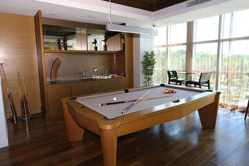 Oasis Grand pool table and community area