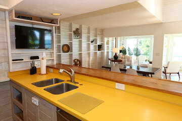 Kitchen features TV and stainless appliances