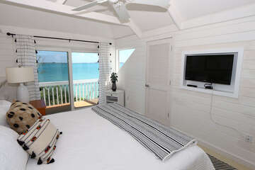 Master Bedroom with king bed, wall-mounted TV and walk-in closet.