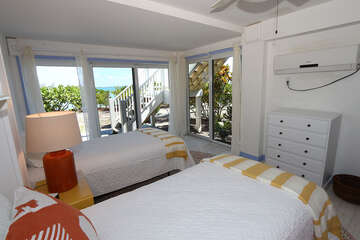 Twin bedroom with wall a/c