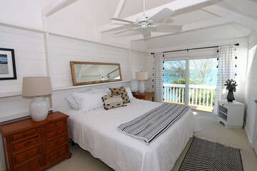 Master Bedroom with king bed, bay front vistas and open balcony