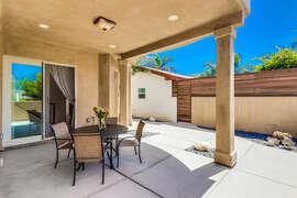 Outdoor seating near front door.