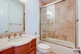 En suite downstairs bathroom in guest master suite.