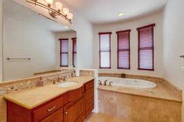 Large soaking tub in master bedroom en suite bathroom.