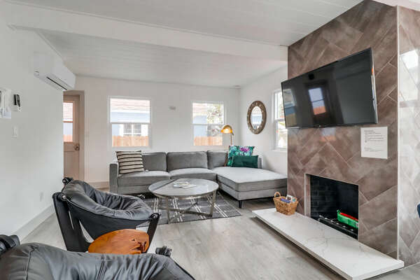 Living Room with fireplace, tv and couch