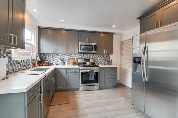 Kitchen with refrigerator and oven