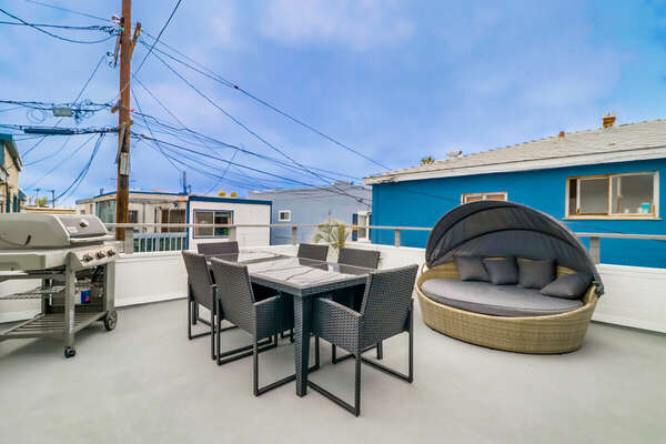 Roof Deck of this Vacation Home in San Diego, with grill and covered seating.