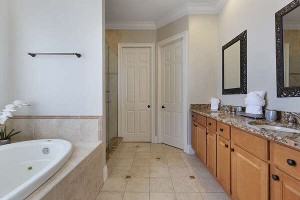 Ensuite bathroom with garden tub, walk-in shower and separate water closet