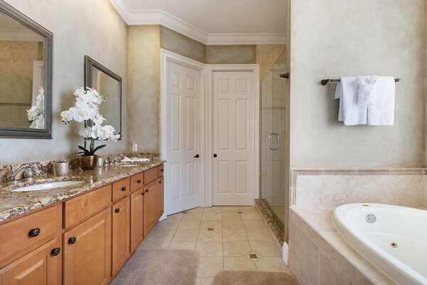 Ensuite bathroom with walk-in shower, garden tub, and separate water closet