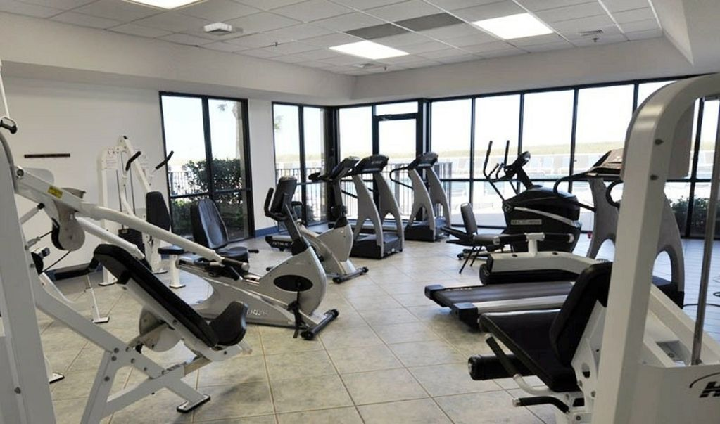 The Fitness Center with Treadmills and Elliptical Machines.