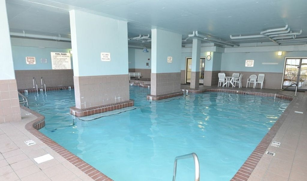 The Indoor Pool with Chairs and Table.