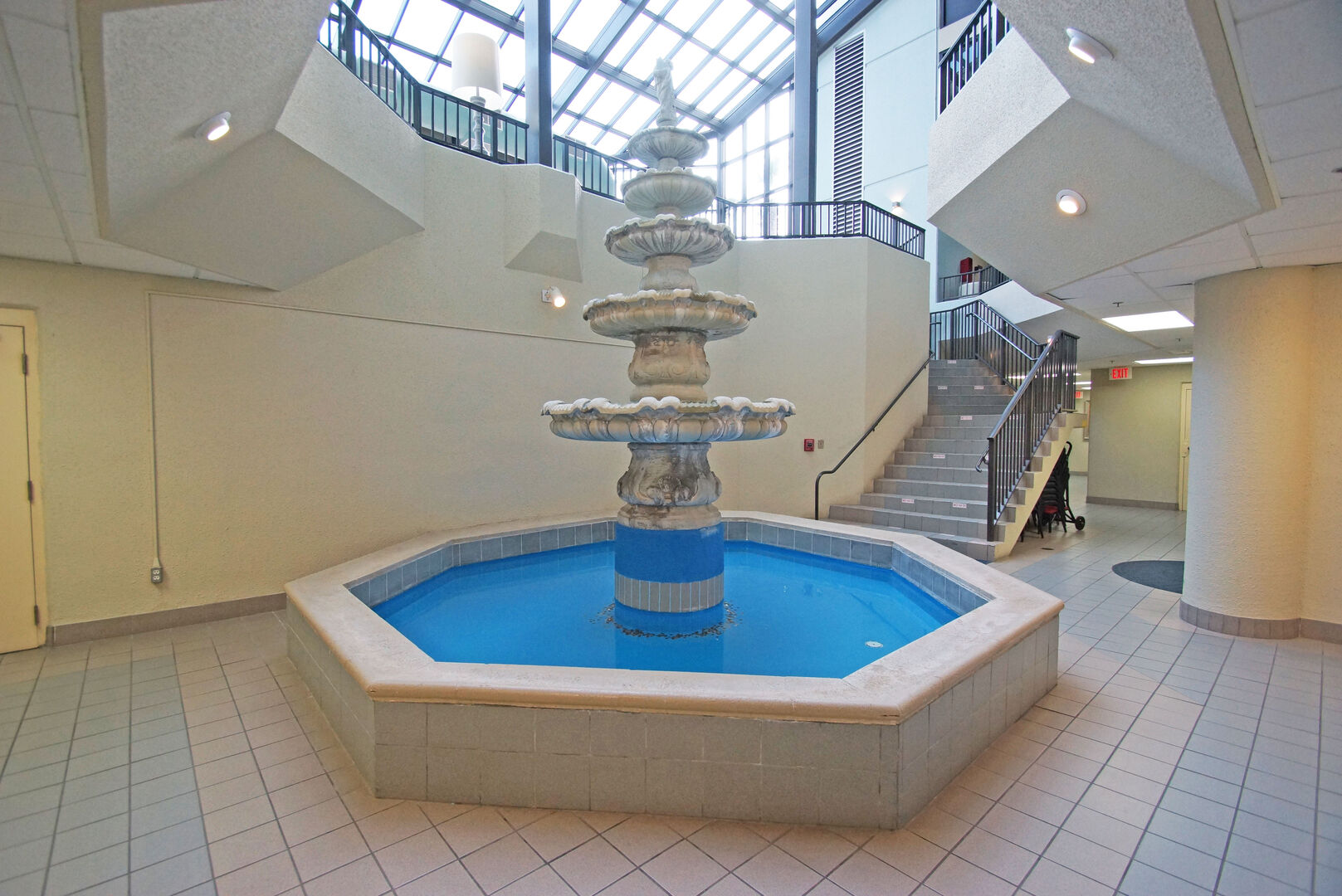 Picture of the Phoenix VI Lobby with a Fountain and the Staircase.