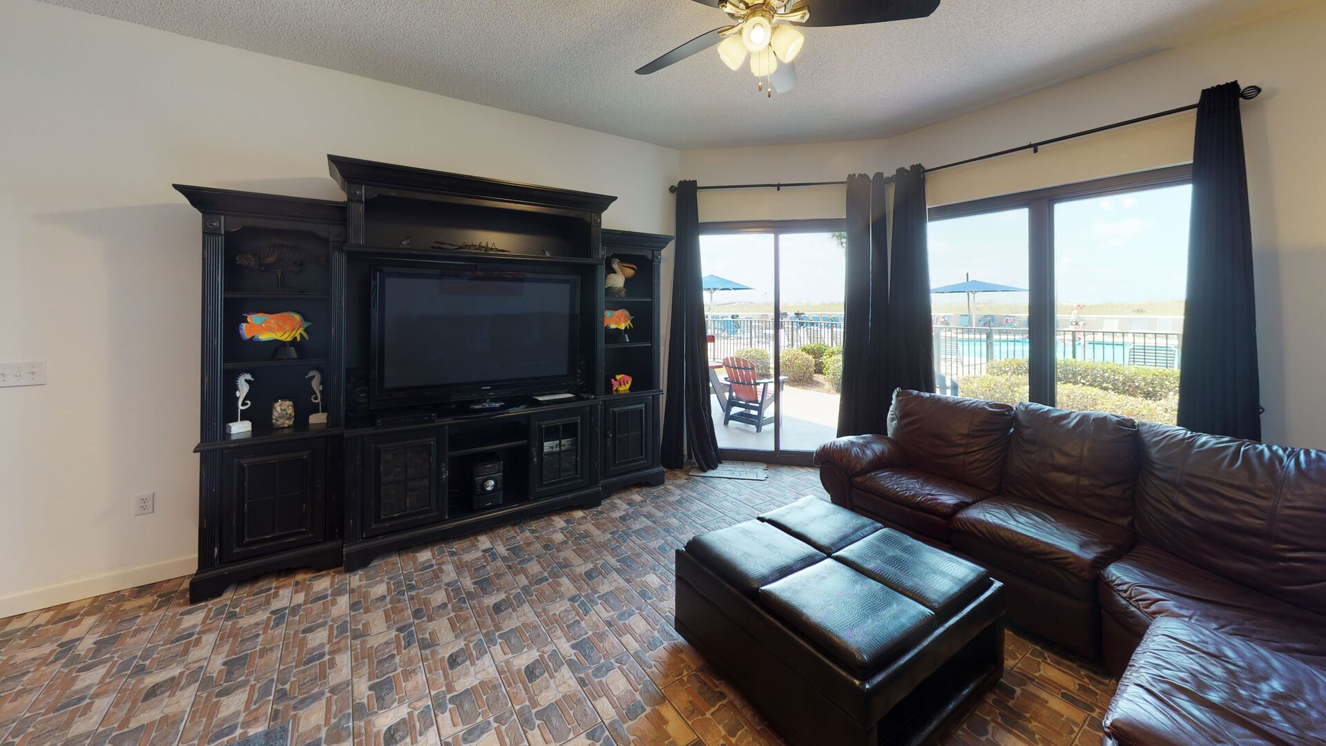 TV Entertainment Center, Sliding Doors to the Porch, and Sectional Sofa.