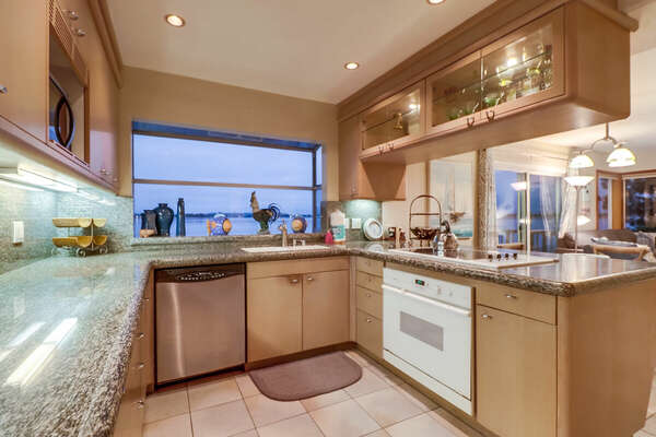 Kitchen with modern appliances and breakfast bar.