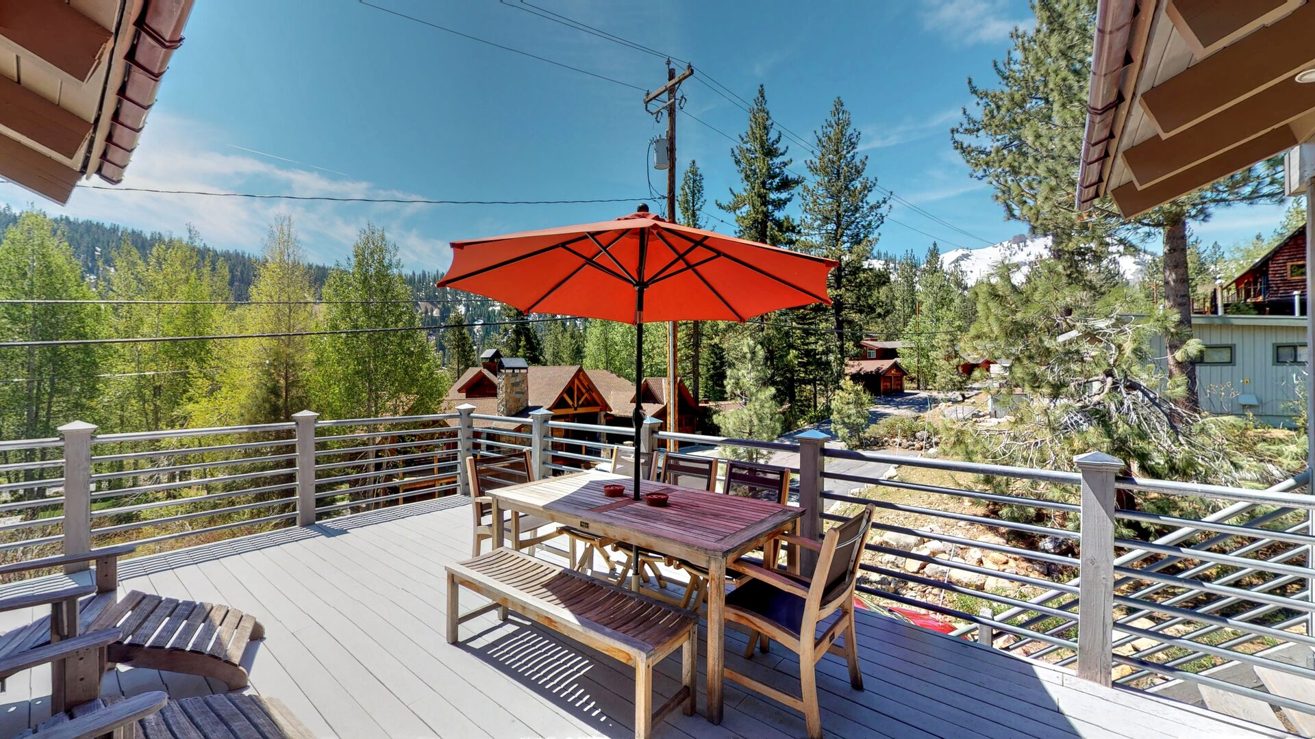 Outdoor seating with umbrella at this squaw valley rental
