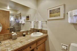En suite master bathroom with tile shower.