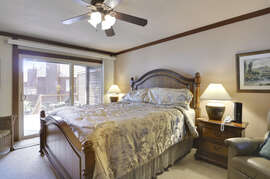 Master bedroom featuring a king bed, flat screen TV and beautiful view of the lake.