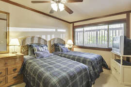 Downstairs room with 2 twin beds and a TV.