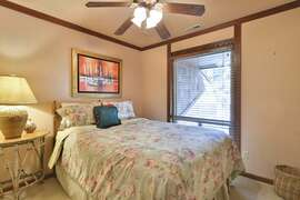 Main level bedroom with a queen bed for two.