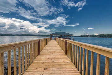 Walkway to the boat house, family picture perfect backdrop here! Stairs on either side provide easy access to the lake.