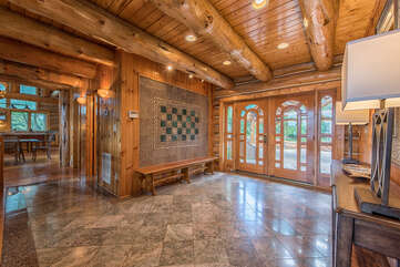 Gorgeous entryway, featuring Italian tile detail walls and floors.