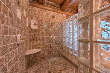 Custom tile & glass shower with two shower heads.