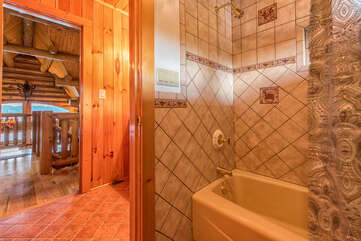 Separate room with shower/tub.