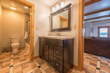 Full bath on lower level for kids bunk room, also easy access from lake.