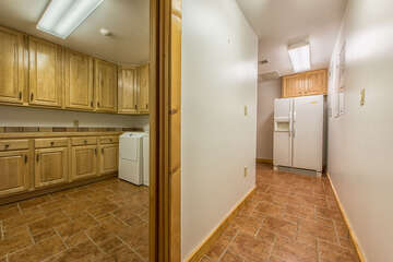 Lower level kitchenette and laundry.